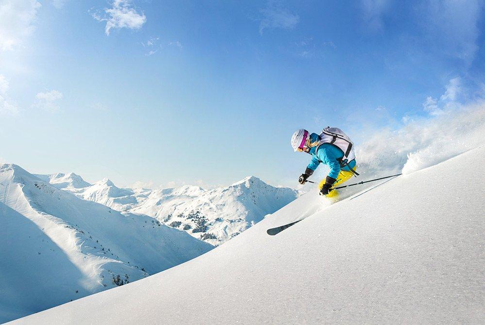 Women skiing down mountain