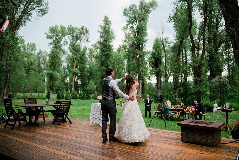 Wedding coule dancing on patio