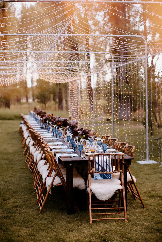 Large guest tables set for wedding