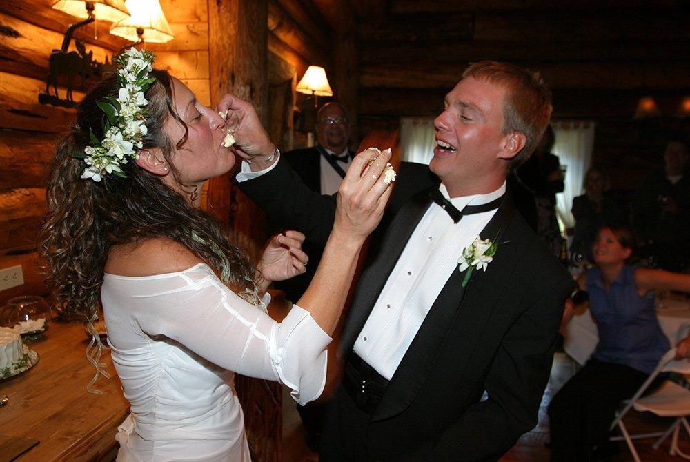 Wedding couple feeding each other cake