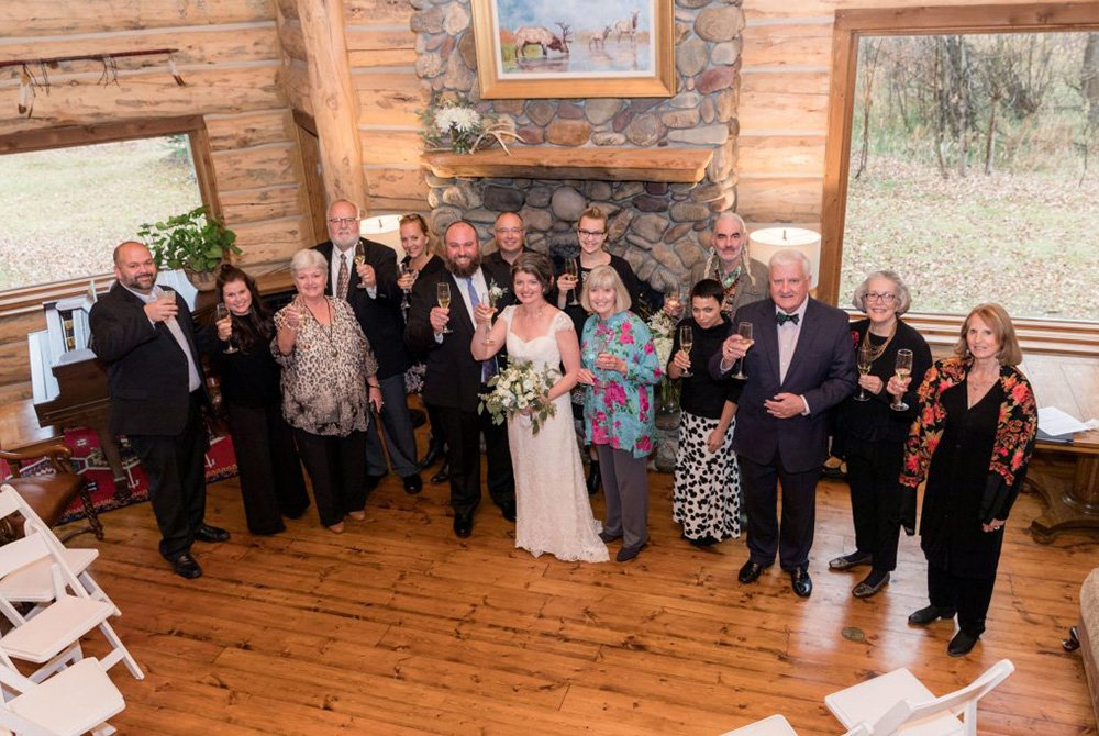 Wedding party posing with raised glasses