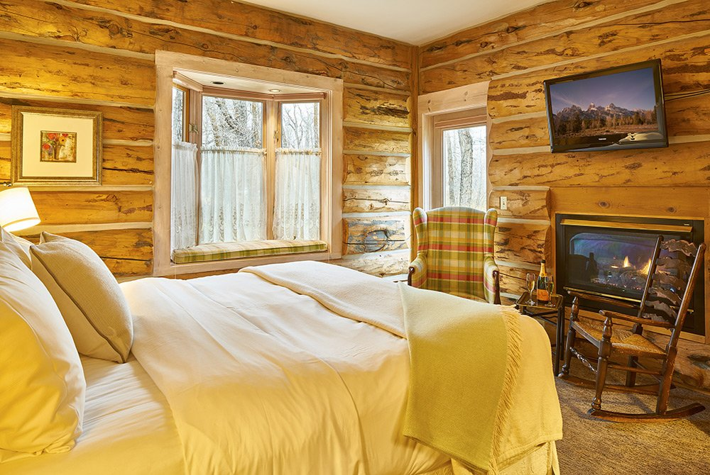 View of rustic cabin room and bed