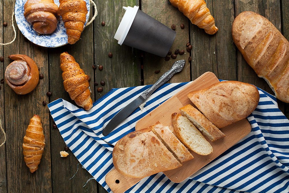 Croissants and sliced bread on a platter