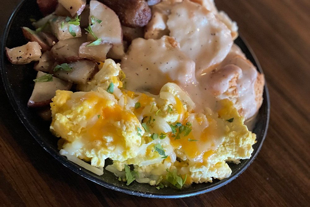 Biscuits and gravy, potatoes, and eggs