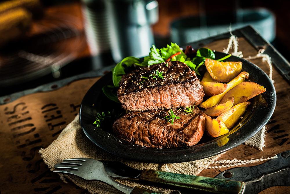 Seasoned steak and wedge fries