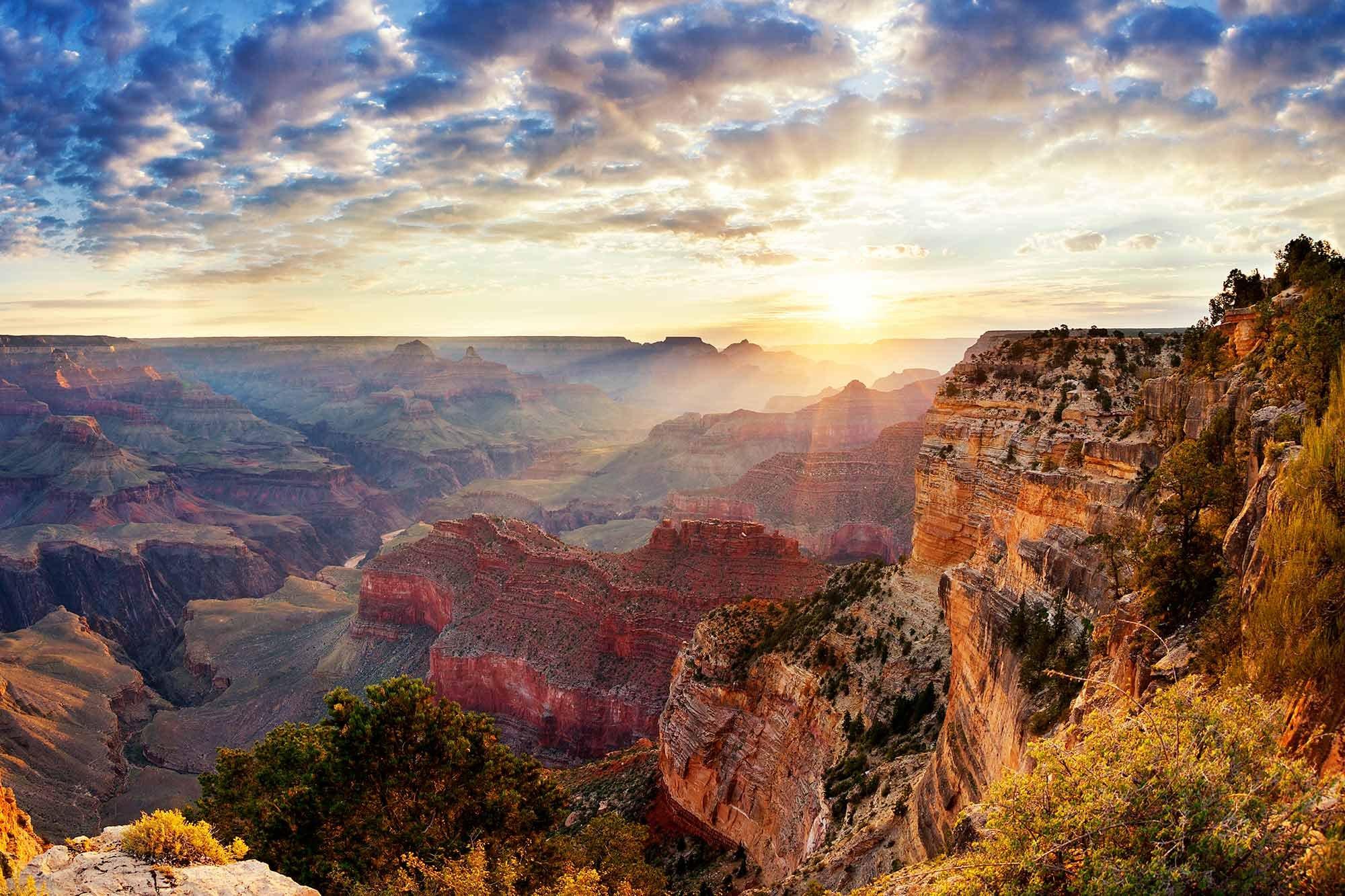 Sunrise peeking over the ridge of the Grand Canyon