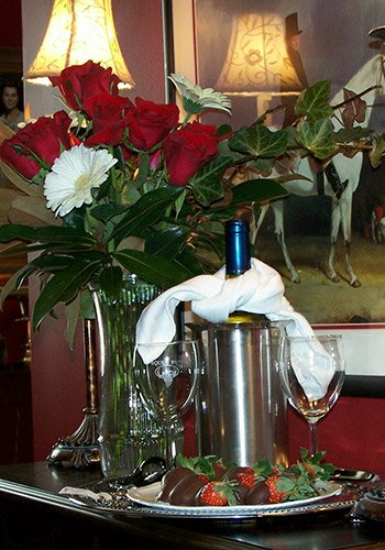 A wine bottle and floral arrangement