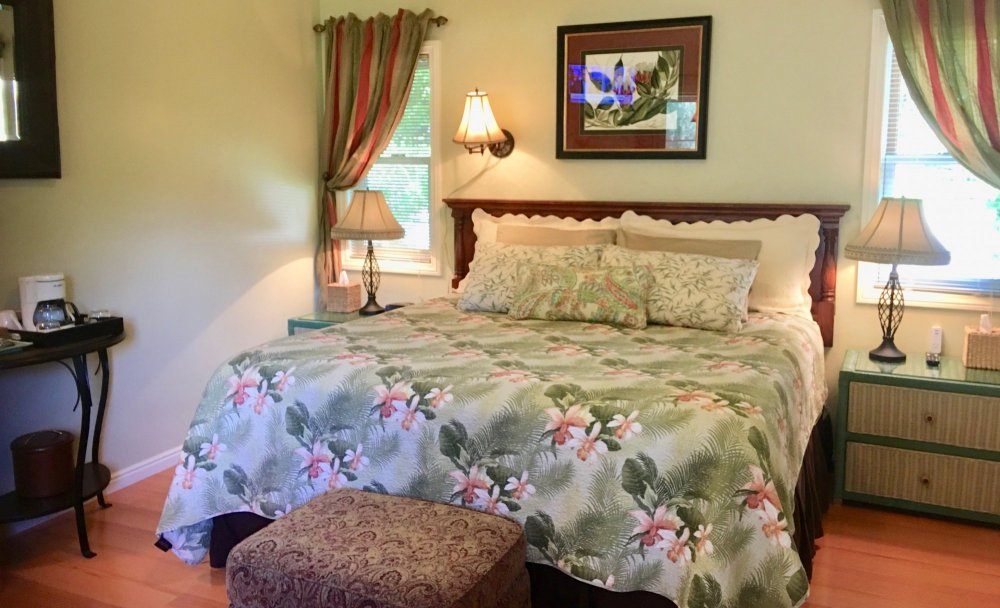 A bed with floral covers
