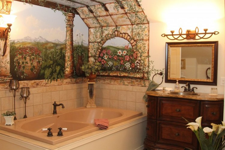 Bathtub surrounded by floral mural