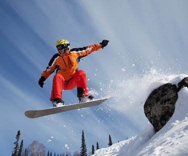Man in orange snowboarding