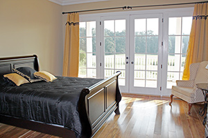 Dressage Suite bed and french doors The Inn at Rosehill in Monroe, North Carolina