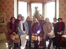 Scrapbooking women in front of christmas tree