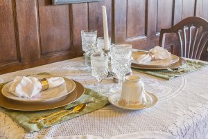Glasses and candlestick set at dining table