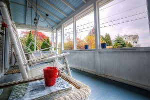 Rocking chair and wicker table on outdoor porch