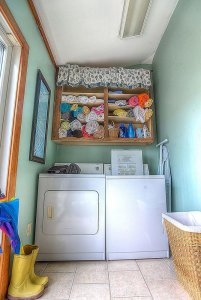 Washer and dryer under towel shelves