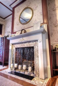 Fireplace and candle decorations under mirror