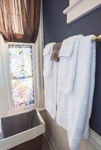 Towels hung on towel rack in bathroom