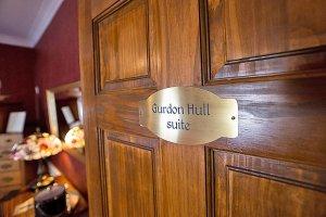 Gurdon Hull Suite nameplate on door