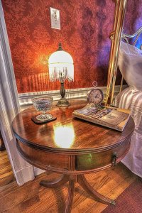 Bedside table and lamp next to bed
