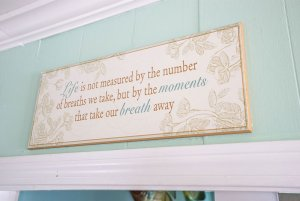 Wood board with quote above doorframe