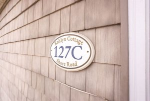 Kaitlyn Cottage nameplate on front of building