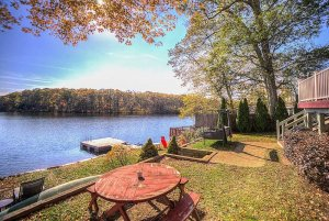 Picnic table in lawn next to lake