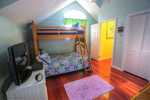 Bunk bed in bedroom with television