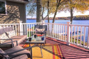 Porch furniture on deck overlooking lake