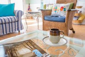 Mug and magazine on glass table