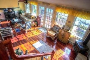 Living room with glass doors to wooden deck