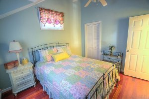 Queen bed next to closet and endtable