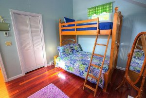 Bunk bed with ladder next to mirror