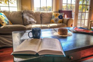 Book and coffee on coffee table