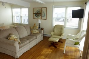 Couch, chairs, and television in living room