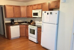 Stove, oven, fridge, and drawers in kitchen