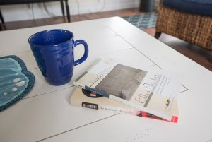 Mug and books on coffee table