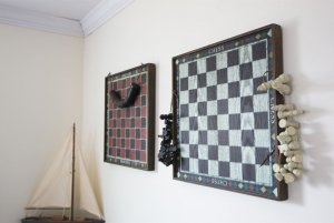 Chess and checkers board hung on wall