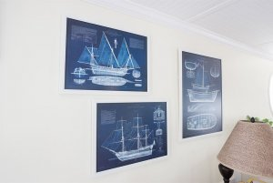 Blueprints of flagship hung up on wall