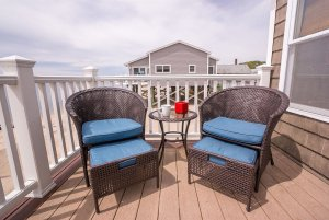 Wicker chairs on wooden deck