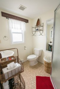 Bathroom with toilet and toiletries baskets