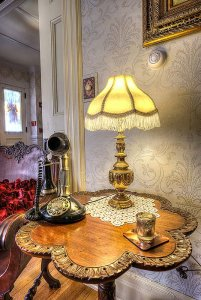Old telephone and lamp on sidetable