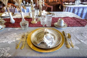 Placesetting with handkerchief and serving dishes