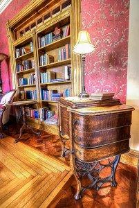 Lamp on drawers next to bookshelf