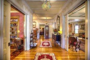 Hallway between living room, sitting area, and bedrooms