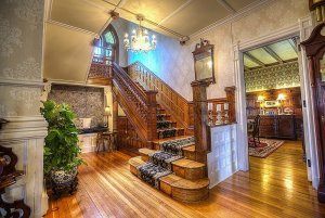 Grand staircase next to dining room