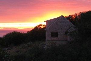 Sun setting behind Bear's Den