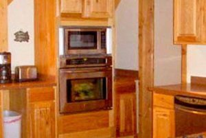 Stove and microwave under cabinets in kitchen