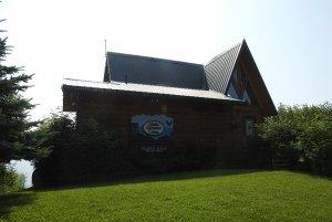 Log cabin with Alaska Adventure Cabins logo