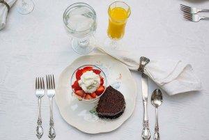 Strawberries and chocolate next to orange juice