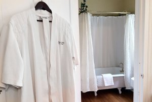 Bathrobe hung on doorway to bathroom